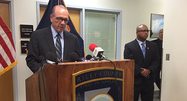 Riley County Police Department Director Brad Schoen, left, holds a press conference with Interim Lawrence Police Chief Anthony Brixius, right, Thursday, July 27, 2017, in Manhattan.
