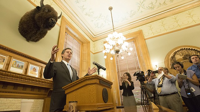 Kansas Gov. Sam Brownback talks with media members during a press conference in which he personally announced his intention to accept President Donald Trump's nomination for him to become the U.S. ambassador at-large for religious liberty, July 27, 2017 in Topeka. Brownback's nomination is pending confirmation by the Senate.