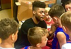 Former Kansas point guard Frank Mason III signs autographs for a group of campers on Friday, July 28, 2017 at Lawrence High. The camp was the second of a four-day stretch of clinics put on by the new Sacramento Kings guard.