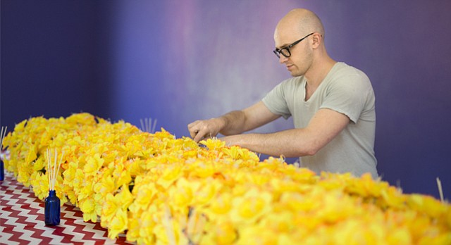 Artist Anson DeOrnery, who goes by the artist name Anson the Ornery, arranges daffodils for his installation Deluge, which runs through Sept. 9 at the Lawrence Arts Center, 940 New Hampshire St.