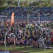Track and field athletes stop in the infield during the USATF National Junior Olympics opening ceremony on Tuesday, July 25, 2017. More than 8,000 athletes attended the Junior Olympics at Rock Chalk Park.