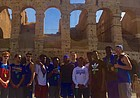 The 2017-18 Kansas men's basketball team takes a moment to pose for a picture in front of Rome's famed Colosseum after a guided tour on Wednesday, Aug. 2, 2017.