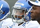 Kansas cornerback Hasan Defense talks with Prinz Kande, a member of the defensive staff, right, during spring football practice on Tuesday, March 28, 2017.