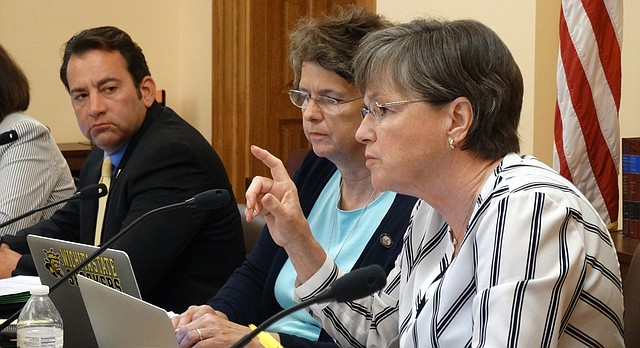 Sen. Laura Kelly, right, asks questions during a Legislative Budget Committee meeting Thursday about progress the state is making to re-certify Osawatomie State Hospital so it can receive Medicare payments while committee chairman Rep. Troy Waymaster and vice chair Sen. Carolyn McGinn look on.