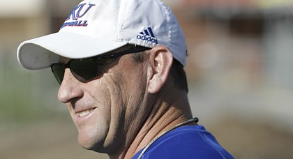 Kansas football head coach David Beaty cracks a smile during the team's second fall camp practice on Tuesday, Aug. 1, 2017.