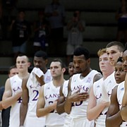 Kansas players listen to their national anthem prior to the start of the basketball match between KU and an Italian selection of players, in Seregno, near Milan, Italy, Saturday, Aug. 5, 2017.