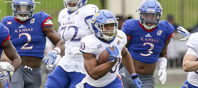 Team Jayhawk running back Khalil Herbert (10) charges up the field on a run during the third quarter of the 2017 Spring Game on Saturday, April 15 at Memorial Stadium.