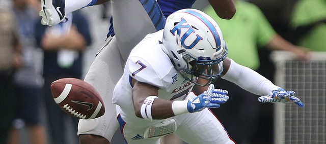 Kansas cornerback Derrick Neal (7) disrupts a pass to Memphis wide receiver Phil Mayhue (89) during the first quarter on Saturday, Sept. 17, 2016 at Liberty Bowl Memorial Stadium in Memphis, Tenn.