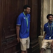 Kansas players, from left to right, K.J. Lawson, Lagerald Vick, Charlie Moore, Billy Preston and Marcus Garrett share a laugh while waiting at the exit of St. Peter's Basilica during the Jayhawks tour of Vatican City on Thursday, Aug. 3, 2017.