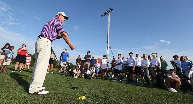 Professional golfer Tom Watson gives a tutorial on proper grip to a group of young golfers on Wednesday, Aug. 9, 2017 at Twin Oaks golf complex in Eudora. Watson made a surprise visit to talk to children who participated in the First Tee program.
