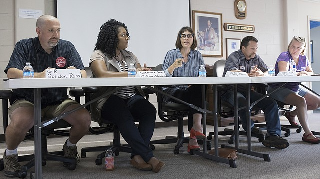 "Seated from left are school board candidates Ronald ""G.R."" Gordon-Ross, Yasmari Rodriguez speaking for Melissa Johnson, Kelly Jones, James Alan Hollinger and Gretchen Lister. The Lawrence branch of the NAACP held a school board candidate forum Thursday evening, Aug. 10, 2017 at the United Way Building."