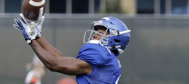Kansas freshman receiver Quan Hampton reaches out for a catch during preseason practice on Monday, Aug. 7, 2017.