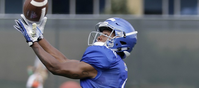 Kansas freshman receiver Quan Hampton reaches out for a catch during preseason practice on Monday, Aug. 7, 2017.