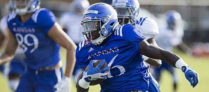 Kansas kick returner Deron Thompson runs up the sidelines during practice on Friday, Aug. 11, 2017 at the practice fields west of Hoglund Ballpark.
