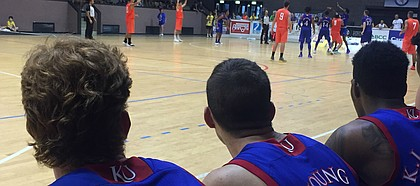 After starring at Lansing High and moving on to Kansas City Kansas Community College, KU walk-on Clay Young's journey with the Jayhawks has taken him places he never would have imagined he'd go. Here Young watches intently from the bench during KU's fourth and final exhibition game in Milan, Italy on Sunday, Aug. 6, 2017.