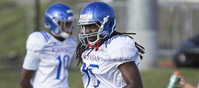 Kansas defensive end Vaughn Taylor Jr. runs through a drill during practice on Friday, Aug. 11, 2017 at the practice fields west of Hoglund Ballpark.