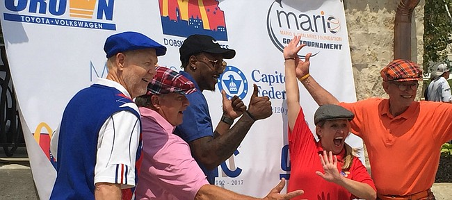 Former Kansas guard Mario Chalmers, center, poses with a few enthusiastic golfers before Monday's ninth annual Mario V. Chalmers Foundation Golf Tournament at The Jayhawk Club in Lawrence.