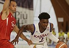 Kansas guard Lagerald Vick, right, goes past an Italian player, during an exhibition basketball game in Rome on Thursday, Aug. 3, 2017.