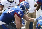 Team KU tight end Ben Johnson (84) braces himself as he prepares for a hit from Team Jayhawks safety Emmanuel Moore (20) during the third quarter of the 2017 Spring Game on Saturday, April 15 at Memorial Stadium.