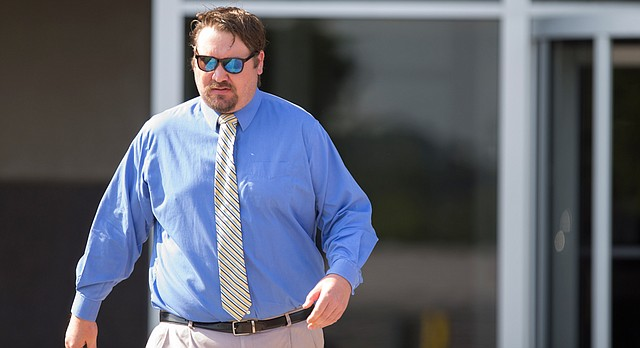 Former Lawrence mayor Jeremy Farmer briefly leaves the Robert J. Dole Federal Courthouse before returning for his sentencing on Tuesday, Aug. 15, 2017 in Kansas City, Kan.