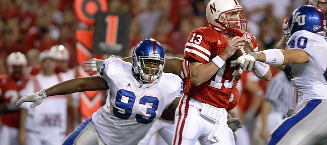 Nick Krug/Journal-World Photo.Kansas defensive lineman James McClinton encloses on Nebraska quarterback Zac Taylor for a sack in the second half.Nick Krug/Journal-World Photo.