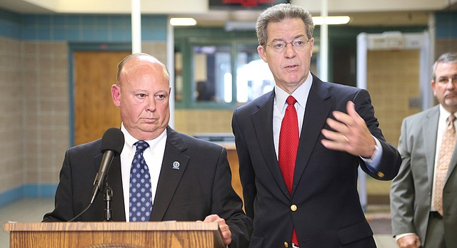 Kansas Gov. Sam Brownback, right, answers questions along with Corrections Secretary Joe Norwood on Thursday, Aug. 17, 2017, after announcing pay increases for the state's correctional officers at the El Dorado Correctional Facility in El Dorado, Kan. (Bo Rader/The Wichita Eagle via AP)