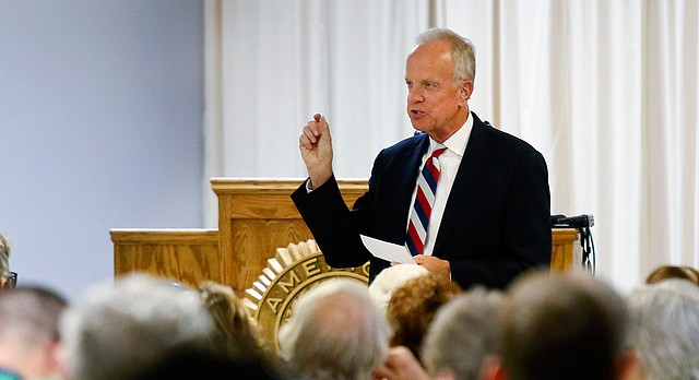U.S. Sen. Jerry Moran, R-Kansas, answers questions from the crowd during a town hall meeting at the American Legion Capitol Post 1 on Friday. Aug. 18, 2017 in Topeka, Kan. (Chris Neal/The Topeka Capital-Journal via AP)