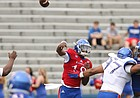 Team KU quarterback Tyriek Starks (18) wings a pass deep to a receiver during the third quarter of the 2017 Spring Game on Saturday, April 15 at Memorial Stadium.