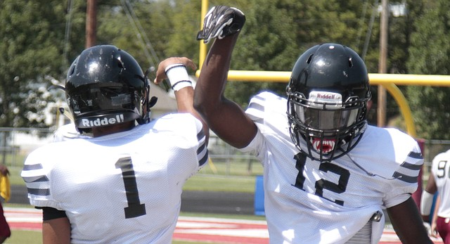 Lawrence High senior quarterback Dante' Jackson (1) and wide receiver Ekow Boye-Doe (12) celebrate after connecting for a long touchdown pass during Saturday's scrimmage at LHS.