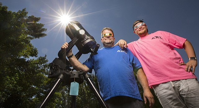 Rick Heschmeyer, left, president of the Astronomical Associates of Lawrence, will be heading to St. Joseph, Mo., with his son, Michael, to experience the eclipse within the path of totality. Heschmeyer has been an amateur astronomer for about 30 years, he says.