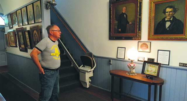Paul Bahnmaier, president of the Lecompton Historical Society, displays the portraits of John Calhoun, a pro-slavery partisan leader in the Kansas Territory, and James Lane, a strident abolitionist who became one of the state's first U.S. senators. The portraits are housed in a building that was used as the territorial capitol of Kansas, not far from Constitution Hall, where a proposed pro-slavery constitution was drafted in 1857 but later rejected by Congress.