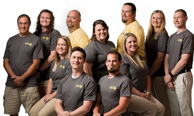 Lawrence Memorial Hospital's sports trainers are pictured here. Back row from left are Ron Wollenhaupt, Leavenworth High School; Jamie Blackim, Lawrence High School; Gary Stevanus, Baldwin High School; Haley Timmons, Basehor-Linwood High School; Mark Padfield, Tonganoxie High School; Meghan Chaffin, Free State High School; and Adam Rolf, LMH Sports Care rehab manager. In the front row, from left, are Danielle Garrison and Jon Vincent, who serve students at several area schools; Joshua Aarnes, Eudora High School; and Haley Holwick, McLouth High School.