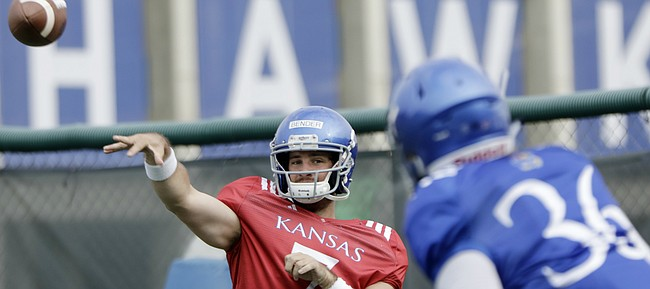 Kansas junior quarterback Peyton Bender fires a pass during a preseason practice on Monday, Aug. 7, 2017.