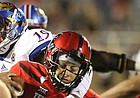 Kansas defensive end Isaiah Bean (19) gets an arm around Texas Tech quarterback Patrick Mahomes II (5) for a sack during the third quarter on Thursday, Sept. 29, 2016 at Jones AT&T Stadium in Lubbock, Texas.