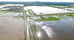Roads and land surrounding the construction site of the new Douglas County Wastewater Treatment plant are flooded just east of the intersection of North 1175 and East 1550 roads, south of Lawrence on Tuesday, Aug. 22, 2017.