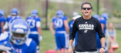 Kansas offensive coordinator and receivers coach Doug Meacham watches over a drill during practice on Monday, Aug. 14, 2017 at the grass fields adjacent to Hoglund Ballpark.