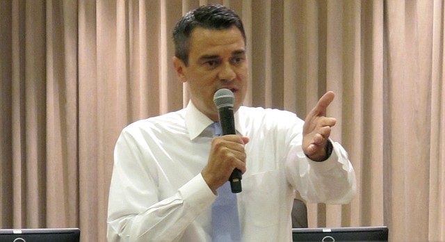 U.S. Rep. Kevin Yoder, R-Kan., answers questions about health care and other issues during a town hall meeting, Tuesday, Aug. 22, 2017, at the city hall in Olathe, Kan. National Democrats already are targeting Yoder for next year's election in a district that President Donald Trump narrowly lost last year. (AP Photo/John Hanna)