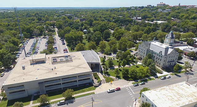 The Douglas County Judicial and Law Enforcement Center, left, and the Douglas County Courthouse building are among the pieces of county property downtown that will be subject to a study by county government officials as they address space needs next year.