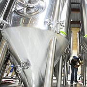 Cellarman Jeramie Gillespie scrubs the brew tanks at the Lawrence Beer Company, 826 Pennsylvania Street, in preparation for Friday's opening. The restaurant and brewery is set for it's grand opening on Friday night.
