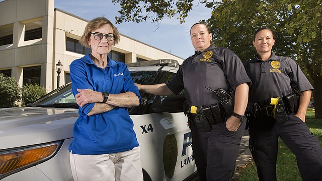 Since the early part of the summer, Susan Hadl, who had a 32-year career with the Lawrence Police Department before her retirement, began doing ride-alongs as a representative of Bert Nash and as part of a co-response team with police officers Sara Mills and Amber Rhoden, to help in calls where a person involved might have mental health concerns. The three are pictured on Friday, Aug. 25, 2017 outside the Law Enforcement Center.
