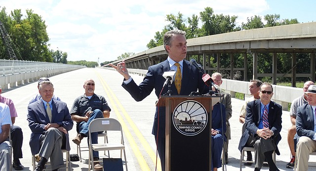 Lt. Gov. Jeff Colyer speaks in Shawnee County to dedicate a rural bridge across the Kansas River. Colyer has been appearing in public more since Gov. Sam Brownback announced he will soon step down, but he carefully avoids discussing policy issues while Brownback is still in office.
