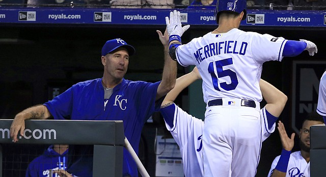 Kansas City Royals' Whit Merrifield (15) is congratulated by Kansas City Royals hitting coach Dale Sveum, left, after hitting a solo home run off Tampa Bay Rays starting pitcher Alex Cobb (53) in the third inning of a Tuesday night baseball game.