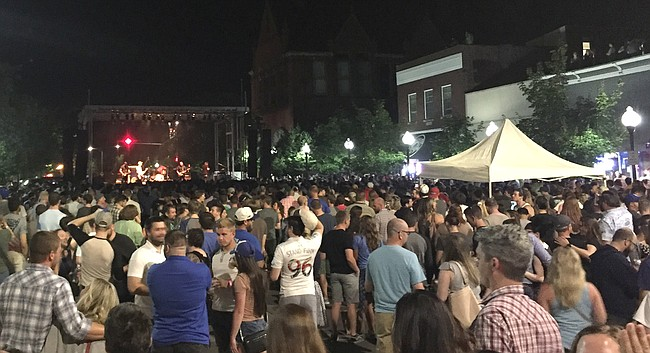 Concertgoers fill the 1000 block of Massachusetts Street to watch the Get Up Kids as part of the inaugural Live on Mass event, June 24, 2017.