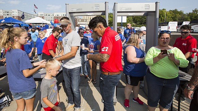 Security crew members check tickets as attendants enter through metal detectors prior to Kansas football's kickoff against Southeast Missouri on Saturday, Sept. 2, 2017 at Memorial Stadium.