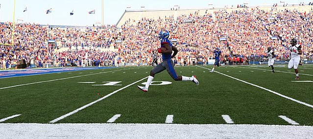 Kansas junior receiver Steven Sims Jr. races down the field for a 77-yard touchdown in the first quarter of Saturday's season opener against Southeast Missouri State at Memorial Stadium.