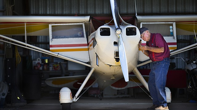 Lawrence resident Jerry Cobb, 74, changes the spark plugs on his 1946 Luscombe 8A on Tuesday, Aug. 29, 2017, at the Vinland Valley Aerodrome. Cobb is a regular fixture at the airport, where he and others spend many hours tinkering on and flying planes.
