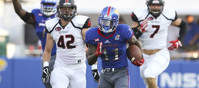 Kansas wide receiver Steven Sims Jr. (11) tears up the sideline on a touchdown run during the first quarter on Saturday, Sept. 2, 2017 at Memorial Stadium.