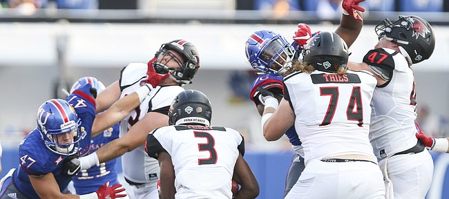 The Kansas defense gets physical while trying to stop Southeast Missouri running back Marquis Terry (3) during the first quarter on Saturday, Sept. 2, 2017 at Memorial Stadium.