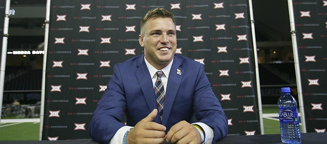 Kansas line backer Joe Dineen Jr. smiles during the Big 12 NCAA college football media day in Frisco, Texas, Monday, July 17, 2017. (AP Photo/LM Otero)