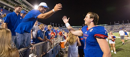Kansas quarterback Peyton Bender (7) slaps hands with fans following the Jayhawks' 38-17 win over Southeast Missouri on Saturday, Sept. 2, 2017 at Memorial Stadium.